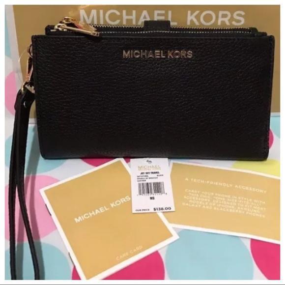 ff4bfd702 M_5b4a1fa3a5d7c669eb5e96c2. Other Bags you may like. MK Chocolate Wallet.  MK Chocolate Wallet. $75.00 $100.00. Michael kors tan wallet